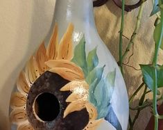 Hand painted gourd birdhouse with sunflower
