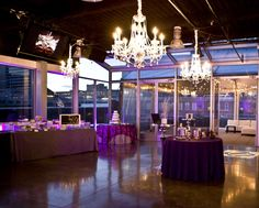 Modern, purple wedding reception at aerial. Check out those chandeliers! // downtown nashville wedding // downtown nashville rooftop // aerial nashville