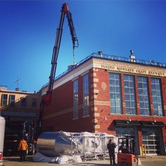 It's a bird...it's a plane...no, it's more #FlyingMonkeys! 4 more brewing vessels are being lifted through the skylight of the @downtownbarrie #waterfront #brewhouse today, increasing production capacity by 50%! #Cheers to more #beer @theflyingmonkeys #VisitBarrie #getoutandplay