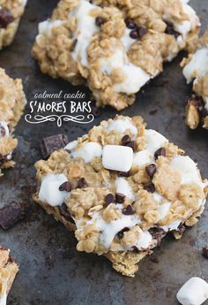Gooey marshmallow-filled, chocolate-layered, graham-cracker crumb coated oatmeal cookie bars.