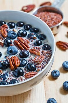 Quinoa Porridge: (serves 1) 1/2 cup quinoa, rinsed     1 1/2 cup milk     1/4 teaspoon vanilla extract     1 dash cinnamon     1 tablespoon maple syrup     1/4 cup blueberries     1 tablespoon peacans, toasted and coarsley chopped.