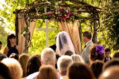 I so love this arch, drapes, & cross...beautiful grounds. Outdoor Wedding In NC