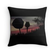 Poppy Pod Silhouette at Sunset THROW PILLOWS -  via @redbubble  w/ Photo of Poppy Pods swaying in the long, Northwestern Summer night breeze. The sun sets slowly behind them- as late as 10:30pm!!  Resulting in an array of colors from Orange, to Hot Pink, and finally, deep Purple.