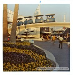 The Peoplemover passes over the entrance to the New Tomorrowland, Disneyland, early 1970s.