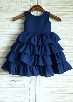 Navy Blue Cotton Cupcake Knee Length Flower Girl Dress - The dress is made of high quality cotton fabric.The listed color is navy blue,many other colors are available as well.The skirt is cupcake style and in knee length.We used 3 wood buttons to de Kids Dress Wear, Girls Blue Dress, Little Girl Dresses, Girls Dresses, Flower Girl Dresses, Flower Girls, Baby Flower, Toddler Girl Dresses, Baby Dress Design