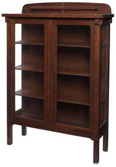 Arts & Crafts Bookcase-Cabinet. Quartersawn Oak with Glass Doors & Side Panels. America. Circa 1900.