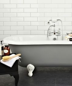Long white bevelled metro tiles with pale grey grout  Diamante White Tile | Topps Tiles