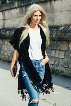 Blue jeans, white shirt, black shawl.
