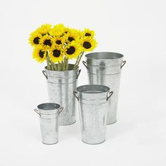 "This 22"" Galvanized bucket can be used as a       flower pail for flower arrangements, centerpiece  vase, or offered as a gift basket for your        guests to take home.                                                                                Size: 22"" tall  10"" opening"