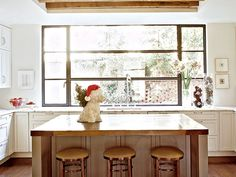 Holiday decor in the kitchen is as understated as the room itself, with a ceramic dog serving as a holiday helper.