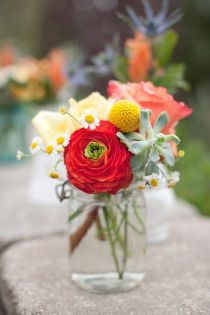 The centerpieces can be eclectic mix of vintage containers (either one large or multi small). Flowers mix of succulents/billyballs/thin white flowers. None matching exactly from table to table in look or mix, but maintain tone and color scheme.