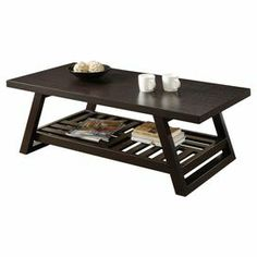 """Rich brown-hued coffee table with a slatted bottom shelf.  Product: Coffee tableConstruction Material: MDFColor: Rich brownFeatures: Slatted bottom shelfDimensions: 16.5"""" H x 47.25"""" W x 23.25"""" D"""