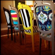 Old chairs, repainted and covered with clourful fabric scraps.