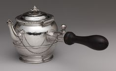 The earliest surviving Parisian silver teapot. (1699)  The custom of tea drinking was still relatively new in France when this teapot was made, and its small size reflects the high cost of tea. Tea never gained the popularity of either coffee or chocolate in France, and silver teapots do not seem to have been produced in large quantities in the eighteenth century.
