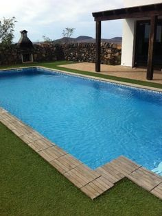 - Pool showing BBQ at the end