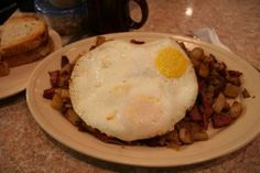 Corned beef hash topped with eggs on top of home fries from The Best Breakfast and Sandwiches in Westerville, Ohio