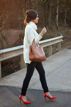 Cozy white sweater with a pop of color, red heels.