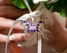 I tied a purple butterfly to my bouquet to represent my Grandmother. I received her rings from James at our wedding!