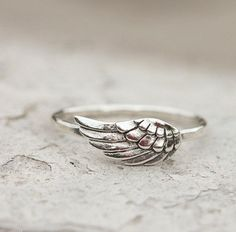Angel Wing, Feather Ring, Angel Jewelry. This is a perfect little sterling silver angel wing ring. Light and easy for every day wear. A great little ring to stack or wear alone. The wing and band are solid sterling silver. The focal measures one half inch long and it is set on a