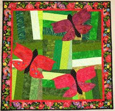 red butterflies on a green background quilt