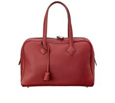 """Victoria II Hermes tote bag in taurillon clemence leather Measures 14"""" x 9"""" x 6.5"""" Canvas lining. With handles, height is 17"""" Madder Red"""