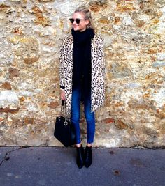 Leopard coat + black polo neck + blue skinny jeans + black boots