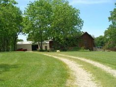 If you are looking for Private this is the place for you! This beautiful Ozarks home is nestled in the woods of this 249 acre farm. With LOTS of marketable timber. The home has a full finished basement with cool/storage room, mud room with shower. The up stairs is open with large master bedroom and bath has jetted tub, right of the master bedroom is a office, could make a great nursery or sewing/craft room. There is a deck off the back to enjoy the beauty of the farm. in Hartville MO