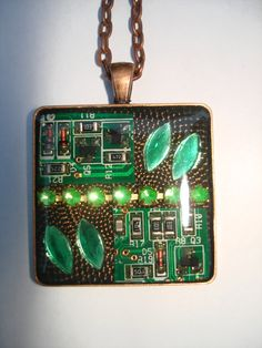Circuit Boards and Crystals Steampunk Pendant Necklace. $20,00, via Etsy.