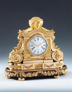 A GILT BRONZE LOUIS XVI CLOCK