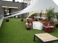 Terrace with artificial grass and wooden floor