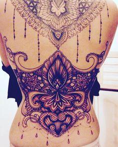 Lace, corset style back tattoo.