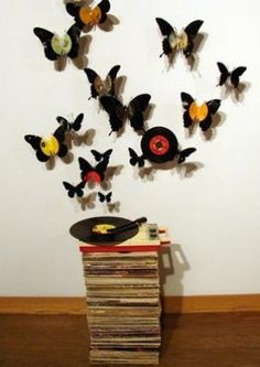I've decorated two walls in our house with records but this is awesome! May try this for the girls room!