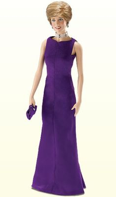 Princess Diana - Purple Gown Vinyl Portrait Doll by Franklin Mint  In June 1996, while in Chicago, Diana once again showed her deep commitment to charitable institutions when she attended a breast cancer benefit at the Field Museum of Natural History. For that gala event, Diana wore a gown of striking purple.