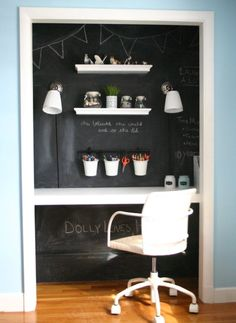 Floating shelves, chalkboard paint, and sconces turned a standard closet into a super-functional office.