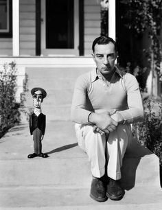 themafucage2:Buster KeatonAmerican silent screen comedian and actor Buster Keaton, known as 'The King of Deadpan' sits beside a model resembling himself.USA, 17th December 1930.