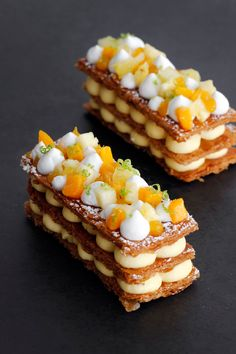 Tropical Mille Feuille Tropical Mille Feuille combining passion fruit, mango and coconut cream layered in 3 golden caramelized puff pastry. This dessert will make everyone say WOW French Desserts, Just Desserts, Delicious Desserts, Gourmet Desserts, Plated Desserts, Elegant Desserts, Cake Recipes, Dessert Recipes, French Pastries