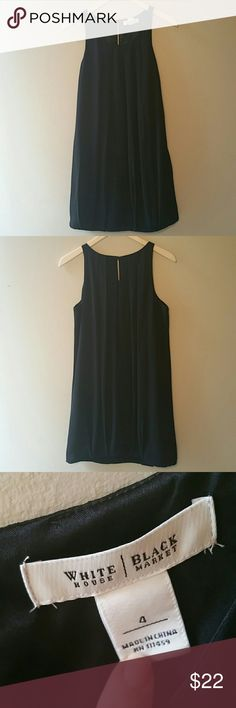 White House-Black Mkt- Blk Balloon Hem Dress Sz 4 Excellent used condition, 100% polyester balloon hem little black dress. Button back closure with key-hole accent . Pleats on front and back are very slenderizing. Wear with your favorite black pump or nude heel. From smoke-free home, no trades, and no PayPal. White House Black Market Dresses Midi