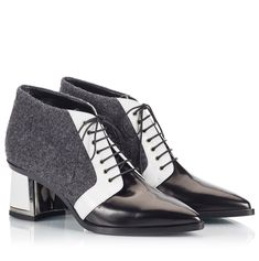 """Alberto Guardianis """"LILLI"""" Ankle boots are inspired by French minimalist and effortless aesthetic. These monochrome ankle boots have been crafted in Italy from a combination of grey felt, white and black polished leather and designed in a brogue-inspired lace-up silhouette in a pointed toeline. The low block heel, whit the metallic plaque adornment, makes them perfect for all-day wear."""