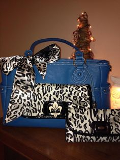 Ocean color Grace Adele Handbag ~ Heather $80.  Style your bag with Reese clutch in Ocelot print.  Add the Ocelot Bag Scarf and Ocelot Qulted Envelope Wallet.