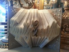 Hey, I found this really awesome Etsy listing at https://www.etsy.com/listing/208401805/happily-ever-after-folded-book-art-home
