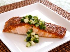 Recipe for broiled salmon with a sweet, golden spice crust topped with a crisp salad made with apples, cucumber and honey. Rosh Hashanah.