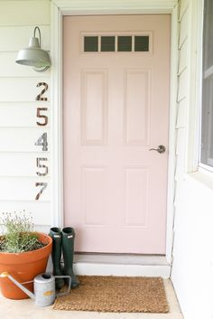 A soft pink door for the front of the farmhouse. The blush front door creates a calm and welcoming setting for the small porch.