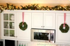 Christmas Home Tour... holiday decor idea for the top of our kitchen cabinets