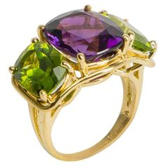 VERDURA Amethyst and Peridot Three-Stone Ring. A Verdura classic. This is the larger of two sizes Verdura creates their classic three stone ring in. Rich amethyst is flanked by bright peridots. Chic and easy to wear. •$7,450