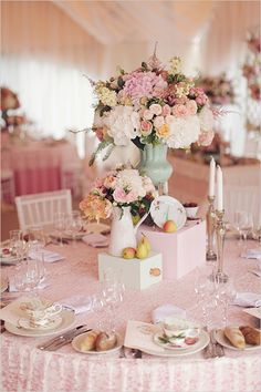 pink wedding ideas tablescape and painted wooden boxes to raise centrepieces. Add mini pumpkins, tea lights, and touch more of orange!