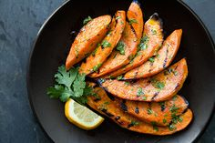Slices of sweet potatoes grilled over a hot fire and slathered with a cilantro-lime dressing.