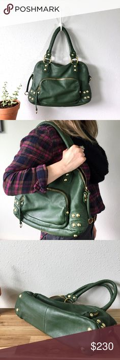 """Linea Pelle Dylan Handbag One of my favs! Hate to part with but rarely use so hope it can make someone else thrilled. Very unique hunter green leather that's hard to find. Gold toned brass and metal hardware. One outer zip compartment and one smaller additional  inner inside zip compartment. Very clean, nearly new condition. Only wear is a few light scrapes on bottom and side metal grommets. Roughly 11"""" tall x 15"""" wide and 5"""" deep across bottom. 8"""" strap drop. Very clean interior. Smoke free…"""