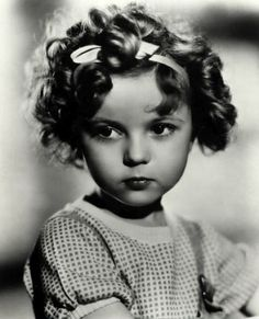 Shirley Temple. Slight pout.