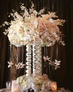 Can hang crystals or anything else to add something different to a tall centerpiece
