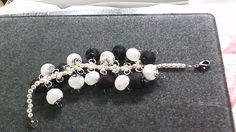 This is a silver and black mesh spacer beads woven bracelet
